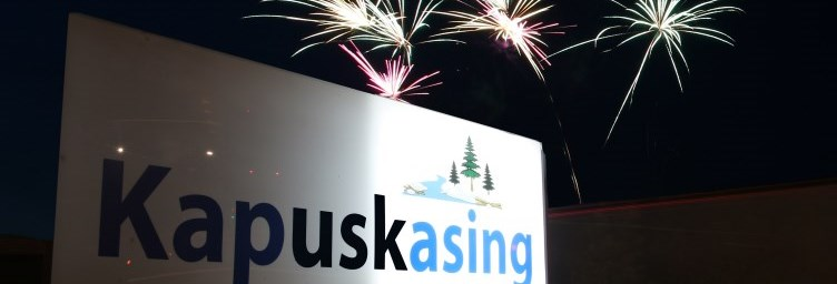 Kapuskasing sign with fireworks in background